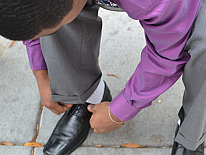 Young man tying his shoes